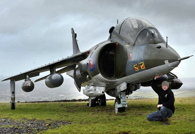 Chris Wilson with the Harrier jump jet he is selling