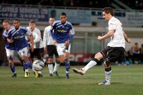 Rob Purdie scores from the penalty spot for Hereford against Macclesfield on Tuesday night