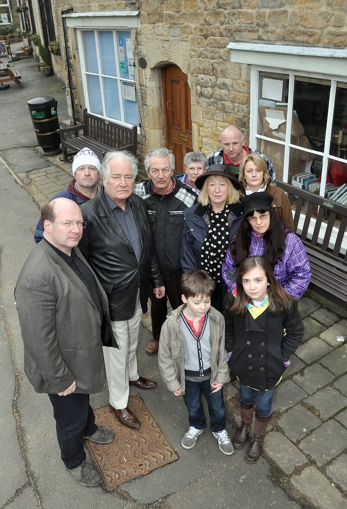 Coun Adrian Naylor (far left) with campaigners outside the Addingham library