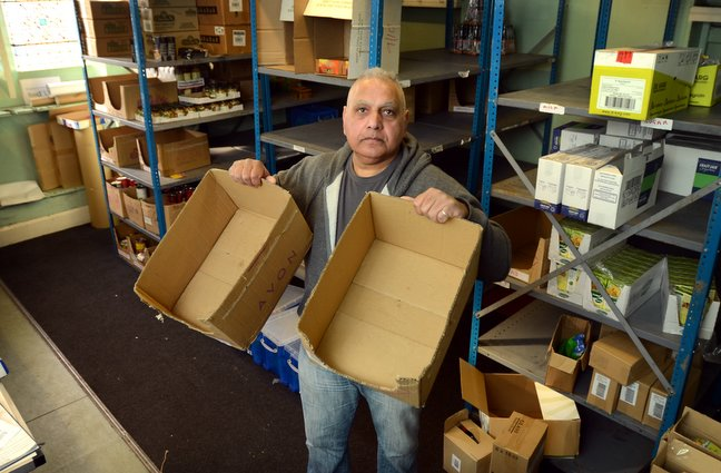 Lashman Singh with empty boxes at the Bradford Food Bank depot in St Mary's Church Hall, Barkerend