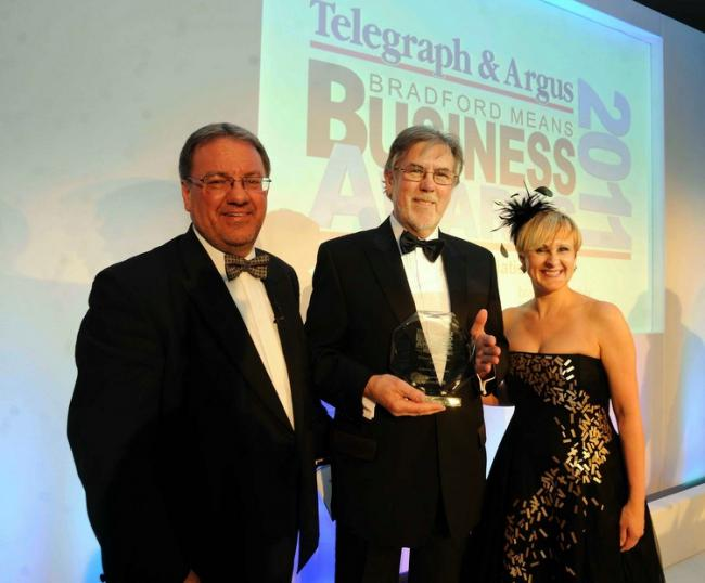 Alan Roper, founder of Ashtree Glass, is pictured (centre) holding the Winners trophy with T&A editor Perry Austin-Clarke (left) and Suzanne Johns of sponsors Approach PR