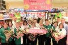 Some of the mothers and children who work at the Morrisons supermarket in Girlington, Bradford