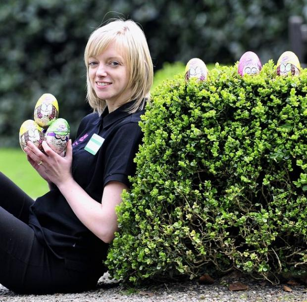 Member of staff Carla Weatherall is pictured with the eggs up for grabs