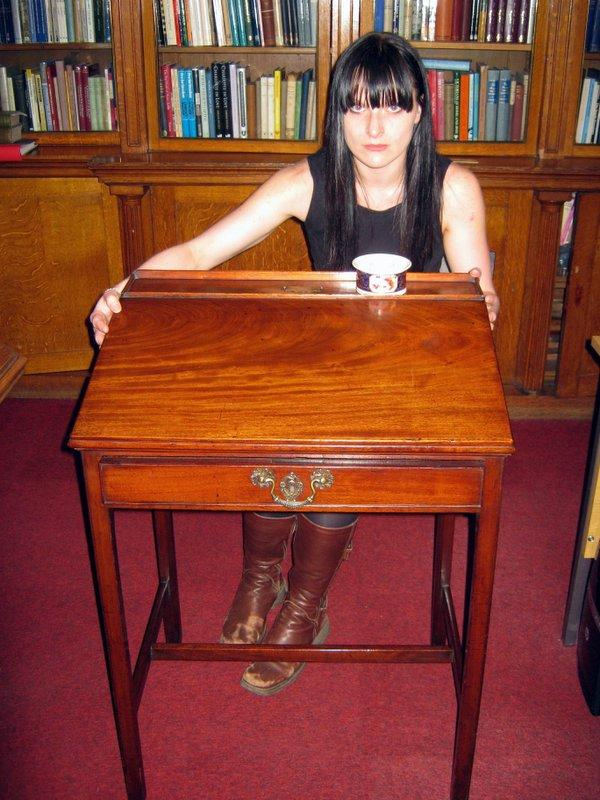 Bronte Museum collections officer Sarah Laycock with the writing desk which belonged to Charlotte Bronte