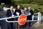 Members of Greenhill Action Group and Shipley MP Philip Davies at the existing swing bridge at Micklethwaite