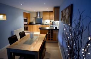 There's a dining area off the kitchen, which has integrated appliances and an island unit