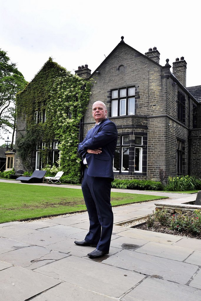 Richard Chadwick in front of Bracken Hall