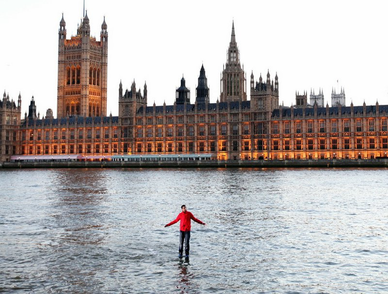 Magician Dynamo 'walks on water' in front of the Houses of Parliament
