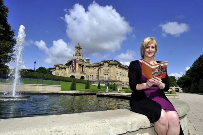 Tricia Tillotson in front of one of Bradford's major attractions, Cartwright Hall in beautiful Lister Park