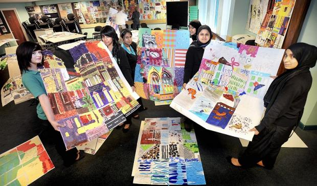 Business and Enterprise College students (from left) Bethany Watmough, Raeesa Chhibu, Samirah Khalifa, Sadia Ali, Simara Shakar and Hajra Razzaq with some of the posters
