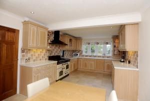 The dining kitchen has a wide range of fitted units, range cooker and integrated appliances