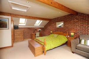 One of the bedrooms has exposed brickwork and roof windows