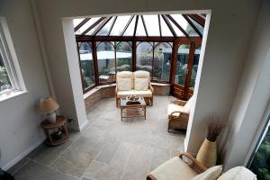 The conservatory has a stone flagged floor and French doors to the rear garden