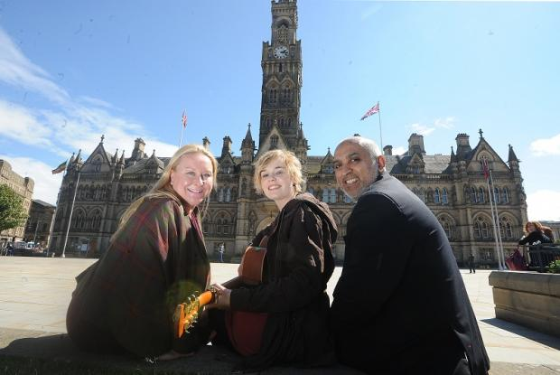 Bella Gaffney, centre, will be performing the song she has specially written for the Positive Bradford Day. She is pictured with Jane Vincent and Saleem Kader