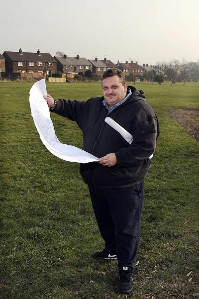 Bradford Park Avenue chief executive Bob Blackburn with plans at  the Phoenix Park site in Thornbury which has now been sold off