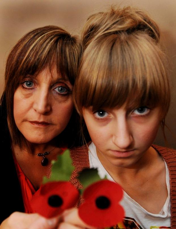 Bethany Holmes with her mother Christine and some of the poppies the teenager was selling