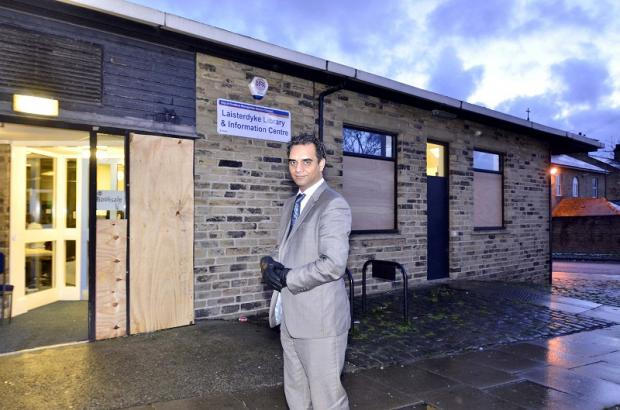 Councillor Mohammed Shafiq outside Laisterdyke Library which has been repeatedly hit by vandalism