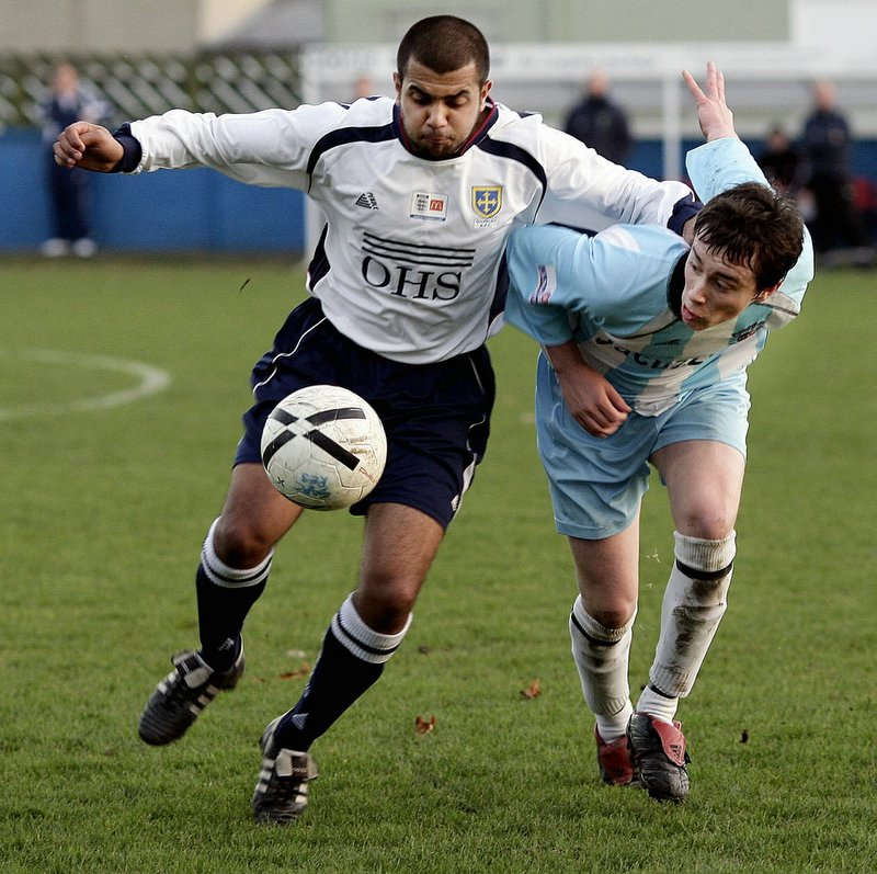 Indy Aujla, pictured playing for Guiseley, is not expecting to defeat either Zesh Rehman or Michael Chopra