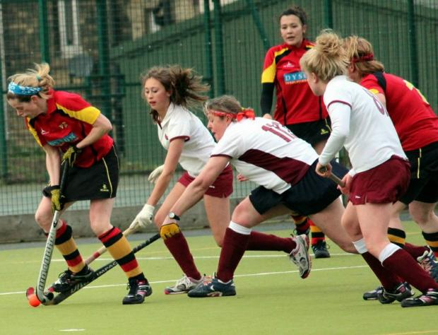 Hard-working Bingley Bees seconds' midfielder Janice Reid comes under pressure from three Ben Rhydding players
