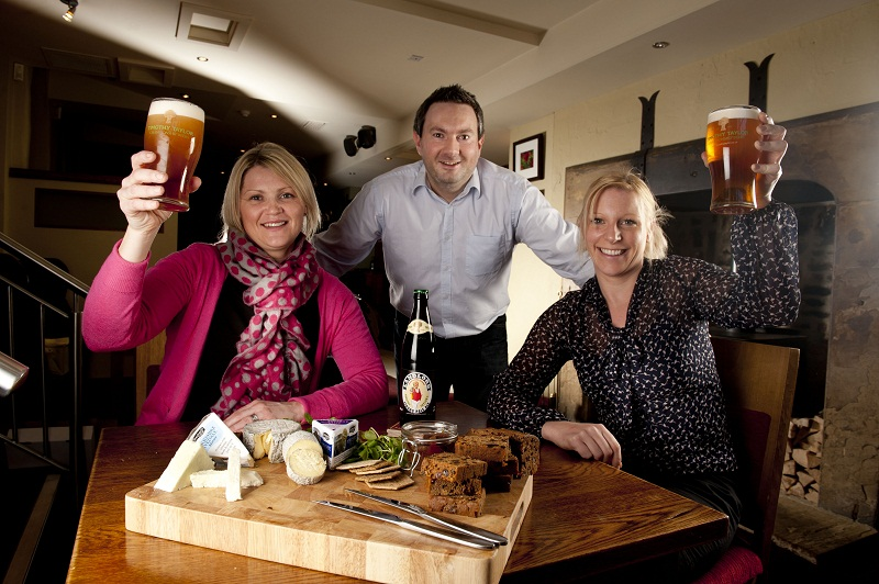 From left, Katie Matten of Shepherds Purse, Adrian Sykes of Timothy Taylor's and Kate Foxon of Just Desserts, celebrate their new venture