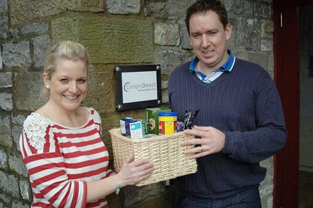 Jessica Tennant and Gareth Roberts, from Comply Direct, with a Home from Hospital hampers