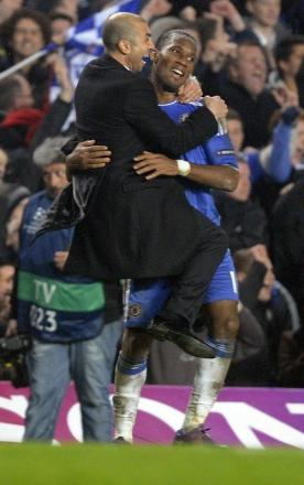 Didier Drogba is hugged by caretaker Chelsea boss Roberto Di Matteo after their midweek Champions League win