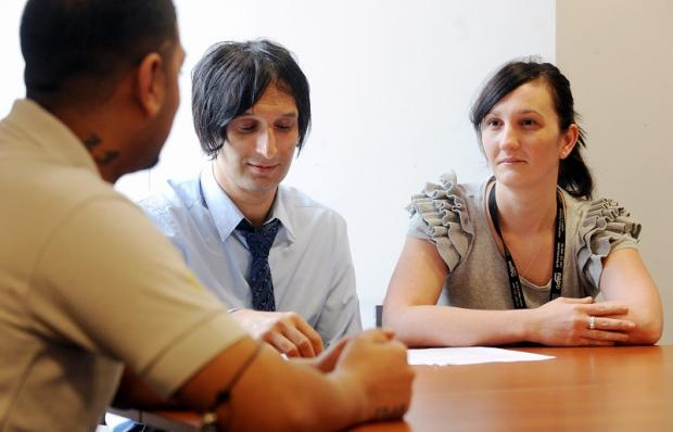 Probation service project manager Sajid Ali and probation officer Rachell Iluk chat to a client