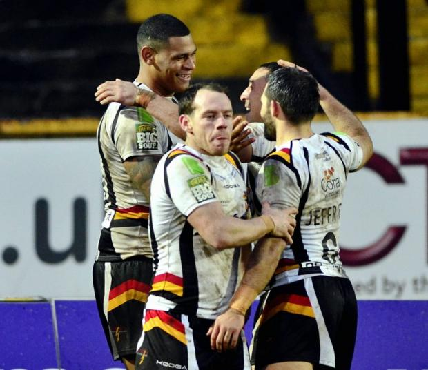 Karl Pryce celebrates with his team-mates after touching down the Bulls' second try against St Helens
