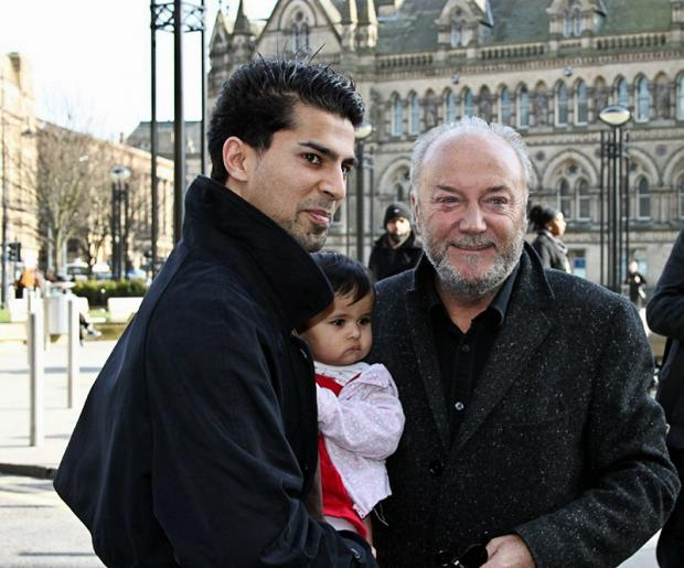 Abu-bakr Rauf pictured with his daughter Arabia and Respect candidate George Galloway outside City Hall