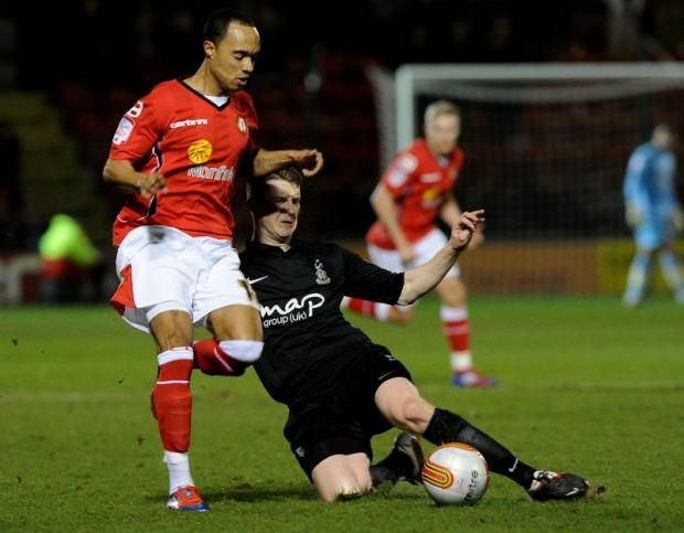 Lee Bullock, who replaced the axed Michael Flynn, tackles Crewe's Byron Moore
