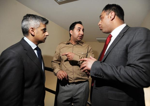 Former offender and now advocate against the attractions of a life of crime Arfan Nazeer (centre) chats to Shadow Justice Secretary Sadiq Khan (left) and Labour's Imran Hussain while on a visit to Manningham's Carlisle Road business centre