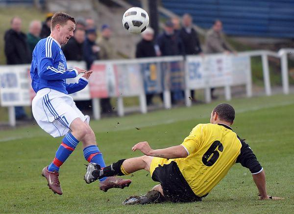 Eccleshill's Charlie Flaherty is challenged by Dinnington's Ben Rosser