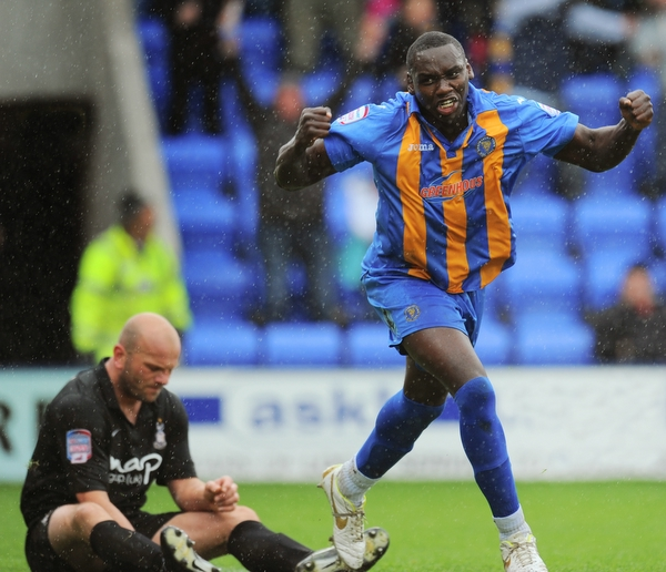 Jermaine Grandison punches the air in delight after scoring the only goal of the match, as Guy Branston ponders what went wrong
