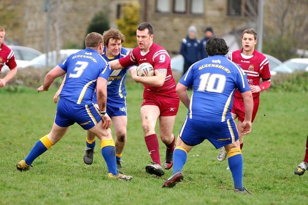 Two tries and five conversions from Andy Robinson helped Wibsey Warriors to a 38-14 victory over Queensbury in the Premier Division. Pictured is Wibsey's Michael Horrocks attempting to steal a few yards