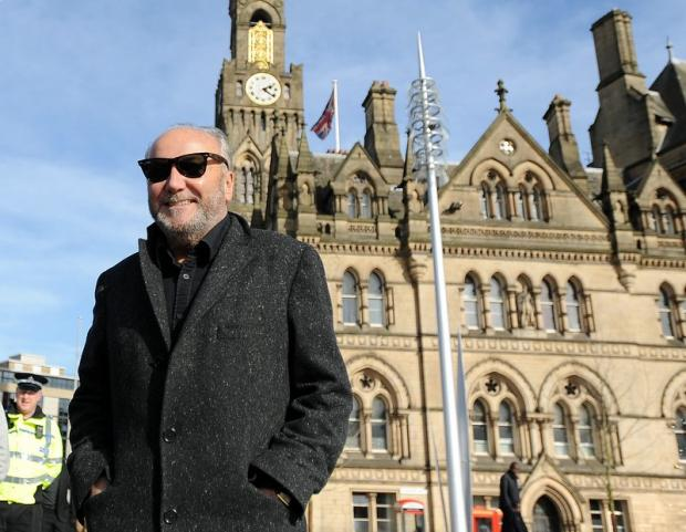 George Galloway, pictured outside City Hall in Bradford, has friends in high places