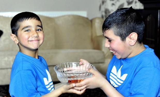 Bradford Telegraph and Argus: Brothers Shazad and Shiraz Sulman with their goldfish