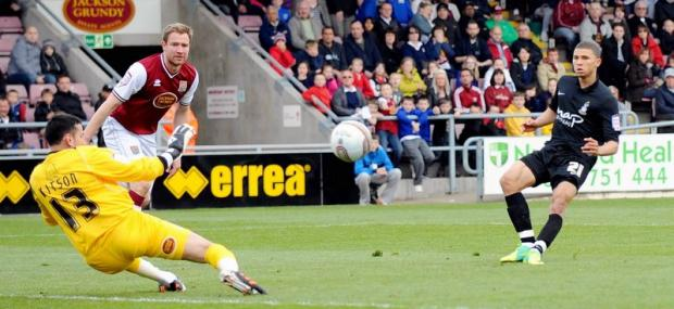 Nahki Wells fires home the first of his three goals at Northampton