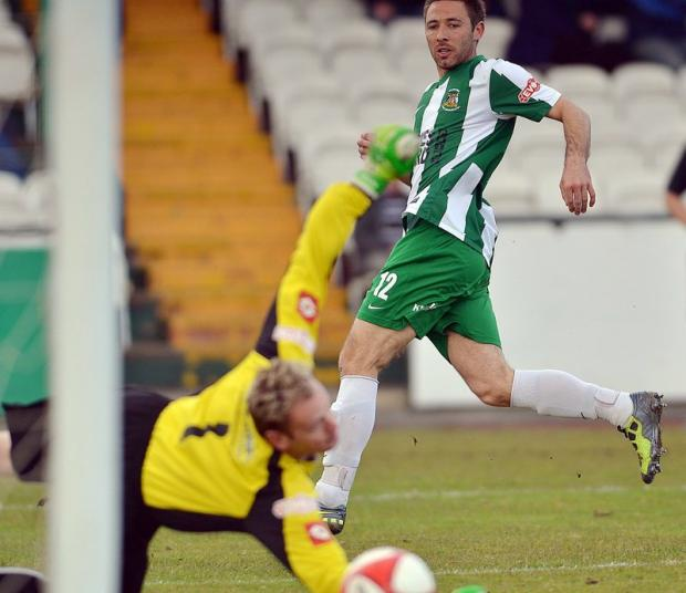 Tom Greaves beats former Avenue keeper Steve Dickinson but is just wide of the far post