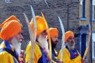 Sikhs on parade with ceremonial swords