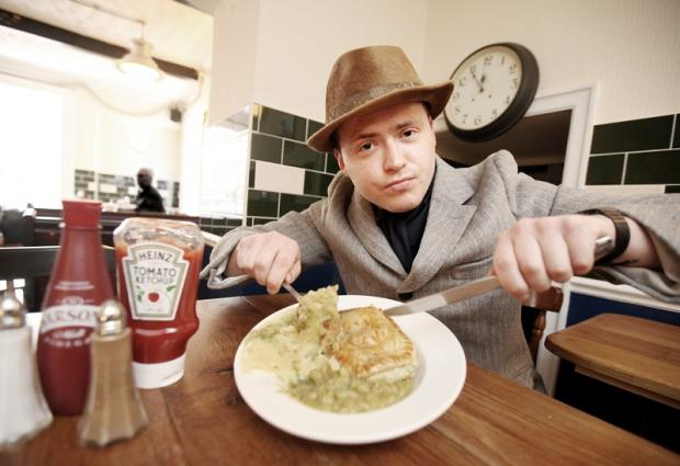 Tucking in: Phillip Lee enjoys some pie and mash