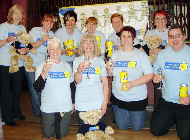 Carol Wright (front row, second left) chairman of the new Wibsey and District Marie Curie Cancer Care              fundraising group and her son Lance Paton (far right) with other members at the group's launch event