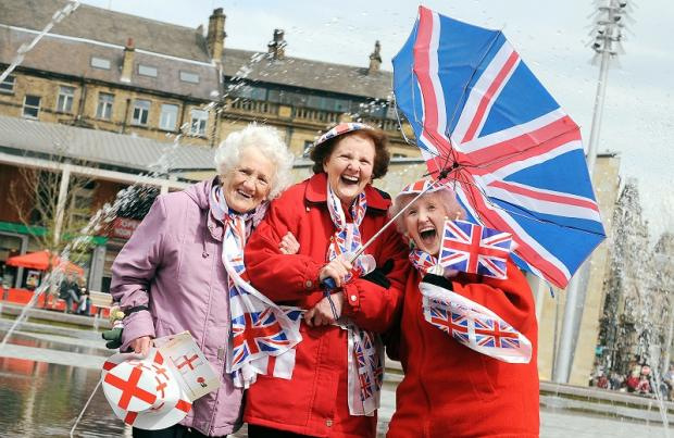 Doreen Auciw, Margaret Spencer and Veronica Quantrill have patriotic fun at today's event