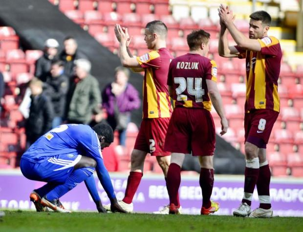 City players applaud the fans after Saturday's home win over Macclesfield. A group of youngsters were given a tour of Valley Parade ahead of the game as part of the restoration of the Junior Bantams