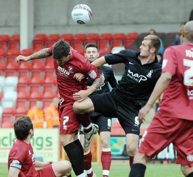 City striker James Hanson makes his presence felt in the Cheltenham area