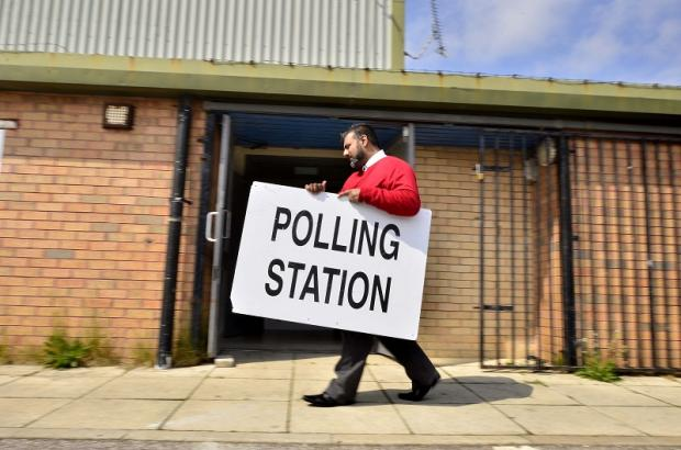 BIG DAY: Sajad Hussain sets up at the polling station at Grange Interlink Community Centre, Manningham