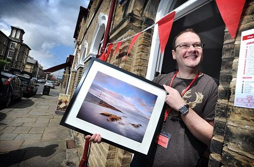 Martin Priestley, a photographer and Saltaire resident, with one of his works