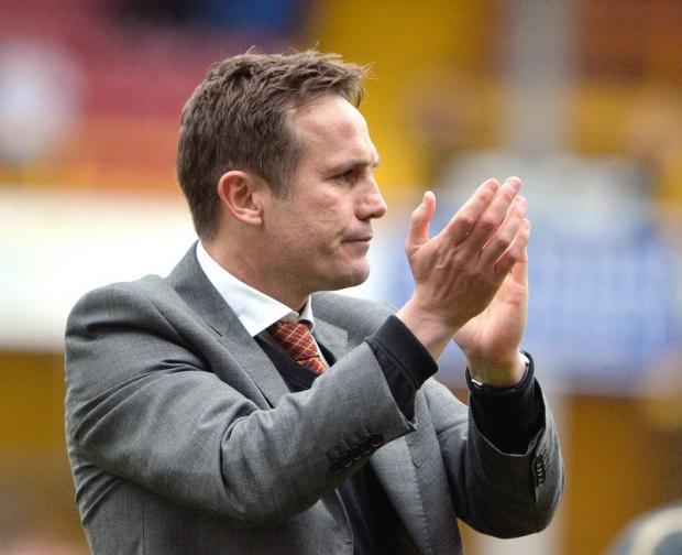 Phil Parkinson, pictured applauding fans after the final game of the season, is tasked with winning over his critics as he leads City into a sixth consecutive campaign in the lowest tier