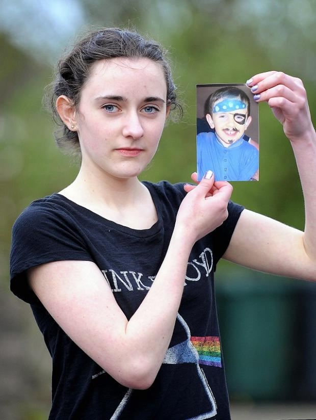 HEARTBROKEN: Katie Rafferty, 14, holds a picture of her brother Daniel, 7, who died in January