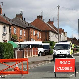 A general view of the scene in Allenton, Derby, after five children died in a house fire
