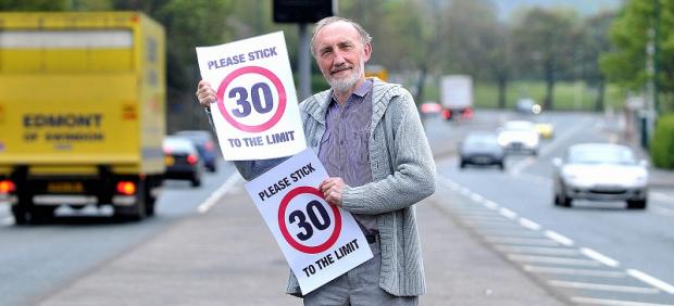 APPEAL: Councillor Geoff Reid with the new electronic 30mph signs in Harrogate Road, Eccleshill
